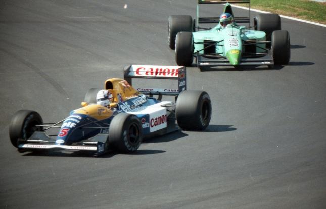 Nigel Mansell (Williams Renault FW14) doblando a Ivan Capelli (Leyton House-Ilmor) - GP Canadá, 1991
